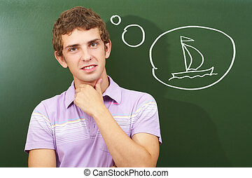 I love sailing - Portrait of smart lad by the blackboard...