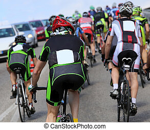 group of cyclists cycling during the race on the road -...