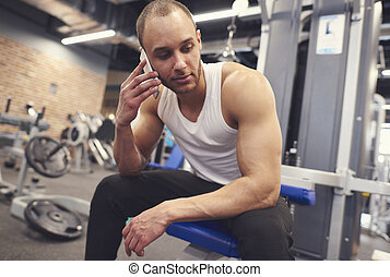 Male athlete having a call over training