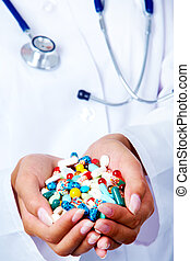Homeopathic remedy - Close-up of vitamins and pills in human...