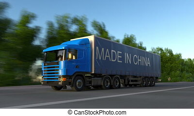 Speeding freight semi truck with MADE IN CHINA caption on the trailer. Road cargo transportation. Seamless loop 4K clip