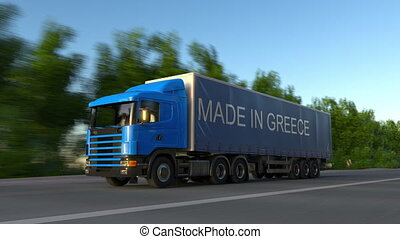 Speeding freight semi truck with MADE IN GREECE caption on...