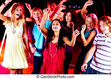 Dancing friends - Joyful teens dancing in night club at...