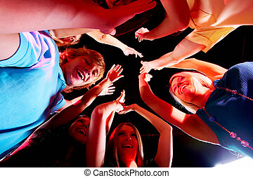 Glad teens - Joyful teens enjoying themselves in night club...
