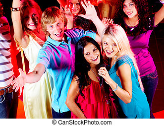 Singing - Photo of pretty girls singing in mic at party with...