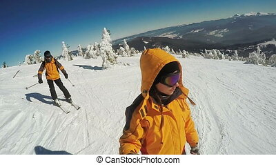 Couple Descent on skis from the snow mountains - Dynamic...