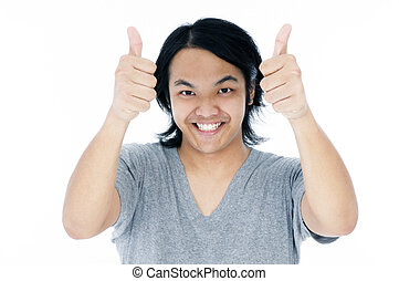 Happy young man giving thumbs up - Portrait of a happy young...