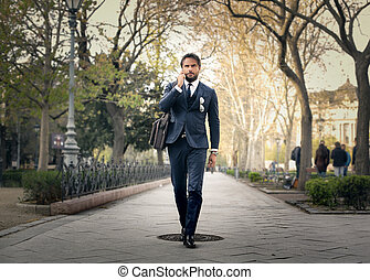 Businessman in park - Businessman walking in park