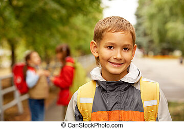 Smiling lad - Portrait of happy lad with rucksack on back...