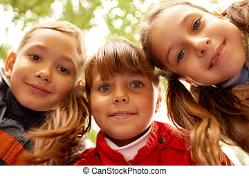 Friendly children - Portrait of happy friends looking at...