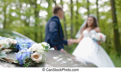 Bride and groom pose in the wood. Young man and woman gently...