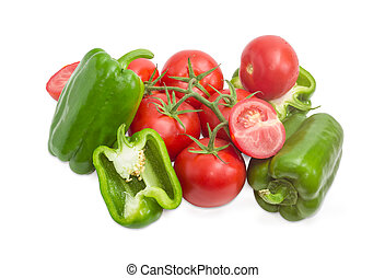Branch of the ripe red tomatoes and green bell peppers -...