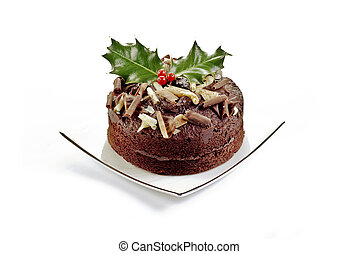Christmas desert - Chocolate cake with holly and red berries...