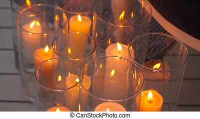 Small candles lightning close up.