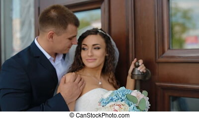 Bride and groom posing outdoors - Caucasian bride and groom...