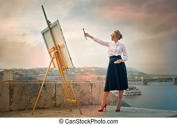 Woman painting ouside - Blonde woman painting ouside