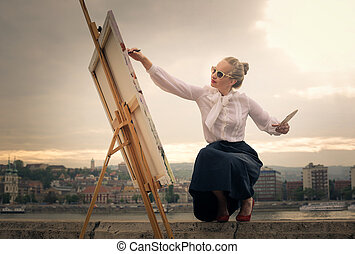 Woman painting outside - Blonde woman painting outside