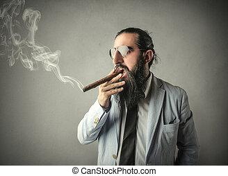 Man smoking cigar inside