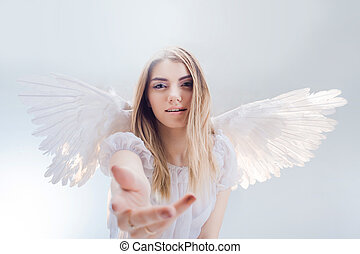 An angel from heaven gives you a hand. Young, wonderful...