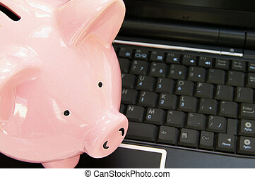 piggy bank on a computer - online banking concept