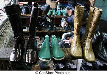 Cobbler - VYSHNIVEC, UKRAINE - 12 November 2008: Shoemaker...