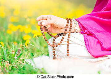 Use of Mala with mantras during a yoga practice flourished...