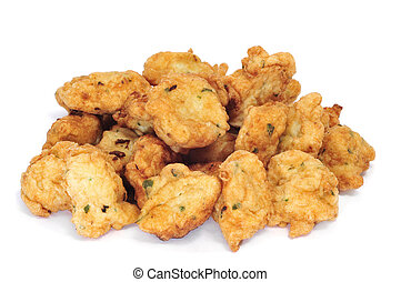 cod fritters - a few cod fritters isolated on a white...