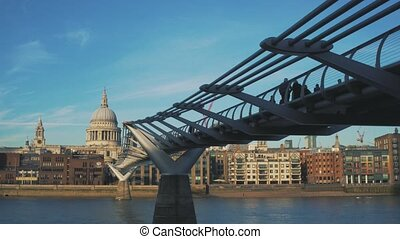 View to Millennium Bridge and Saint Paul's Cathedral from Thames embankment.