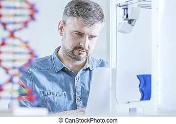 Scientist working at laboratory - Concentrated male...
