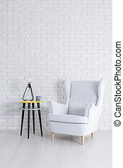 White brick wall - Simple interior with white brick wall and...