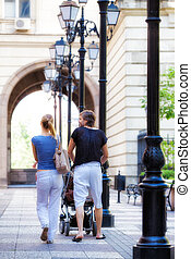 rear view young couple summer outdoors - A view of a young...