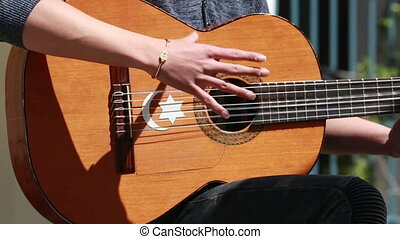 Man Playing Traditional Spanish Flamenco Guitar - Closeup Of...