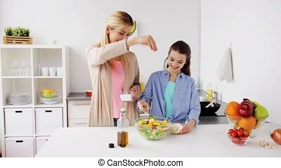 happy family cooking salad at home kitchen