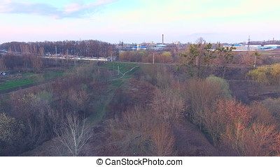 railroad near brickwork plants and factories at sunset -...