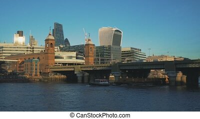 View to the City and London Bridge from Thames embankment.