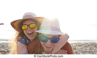 Pretty couple in love having fun on beach holidays together.