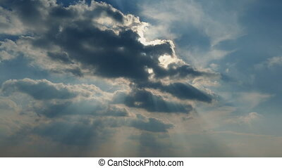 Sun Shines Out From Clouds - Large clouds moving past the...