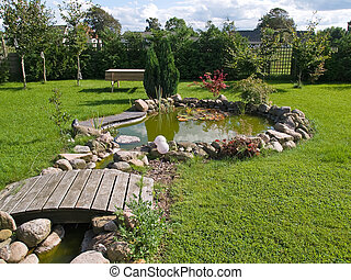 Beautiful classical garden fish pond gardening background -...