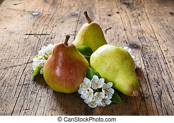 Red pear with flowering pear - Red pear, flowering pear, on...