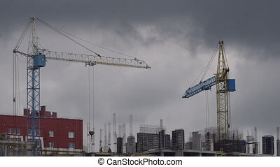 The crane works on the construction site - Construction...