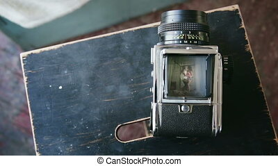 View on video recorder of old moving-film camera of happy...