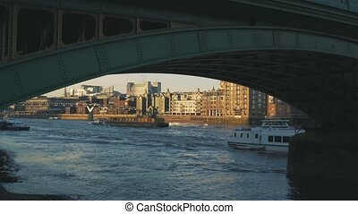View to the City of London and Millennium Bridge from under...