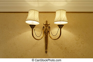 Luxury hanging lamp on marble wall - interior decoration