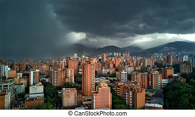 Medellin Colombia Rain storm with clouds approach city with buildings in shot. Latin / South America