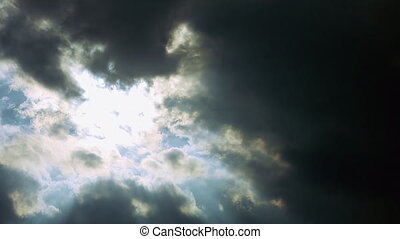 Storm dark rainy clouds moving over sun. Stormy weather...