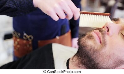 barber cleaning male face with brush at shop - beauty,...