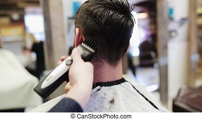 man and stylist doing haircut at barber shop - beauty,...