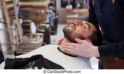 barber applying aftershave lotion to male neck - beauty,...