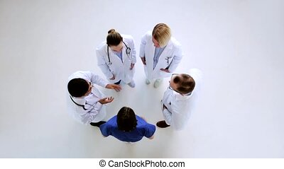 group of doctors talking at hospital - medicine, healthcare...