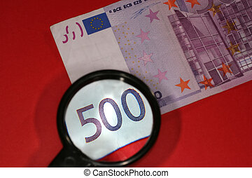 closeup of european currency - Looking through magnifying...
